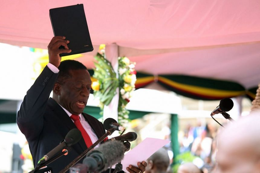New Zimbabwean President Emmerson Mnangagwa takes the oath of office as he is sworn in.