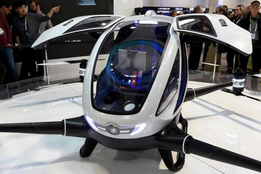 EHang's E-184 drone can carry one passenger in its small cockpit, but the firm says it is working on a model that can carry two.