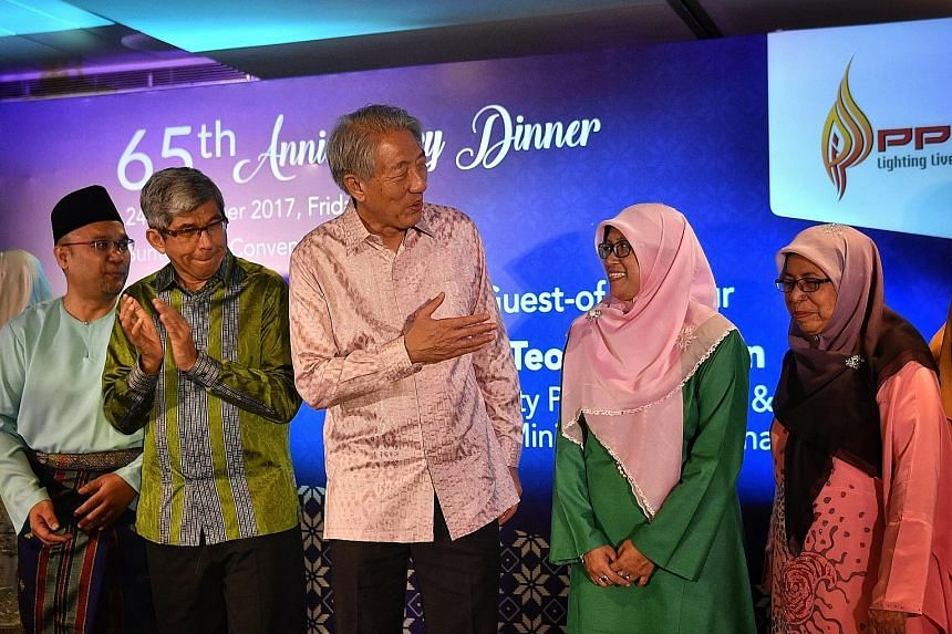 Deputy Prime Minister Teo Chee Hean and Minister-in-charge of Muslim Affairs Yaacob Ibrahim, with (from left) PPIS chief executive Mohd Ali Mahmood, PPIS president Rahayu Mohamad and PPIS adviser Fatimah Azimullah, at PPIS' 65th anniversary gala dinn