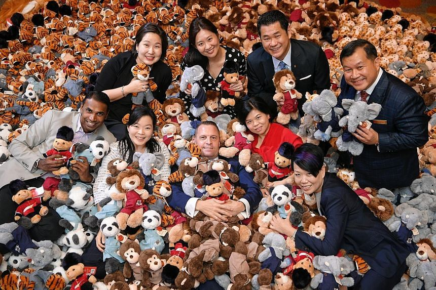 With the soft toys are (clockwise from top left) M Social Hotel's Ms Lee Sul Bi; M Hotel's Ms Jacqueline Ho; Copthorne King's Hotel's Mr Kung Teong Wah; Grand Copthorne Waterfront Hotel's Mr Cheong Hai Poh; Orchard Hotel's Ms Tina Sim; ST School Pock