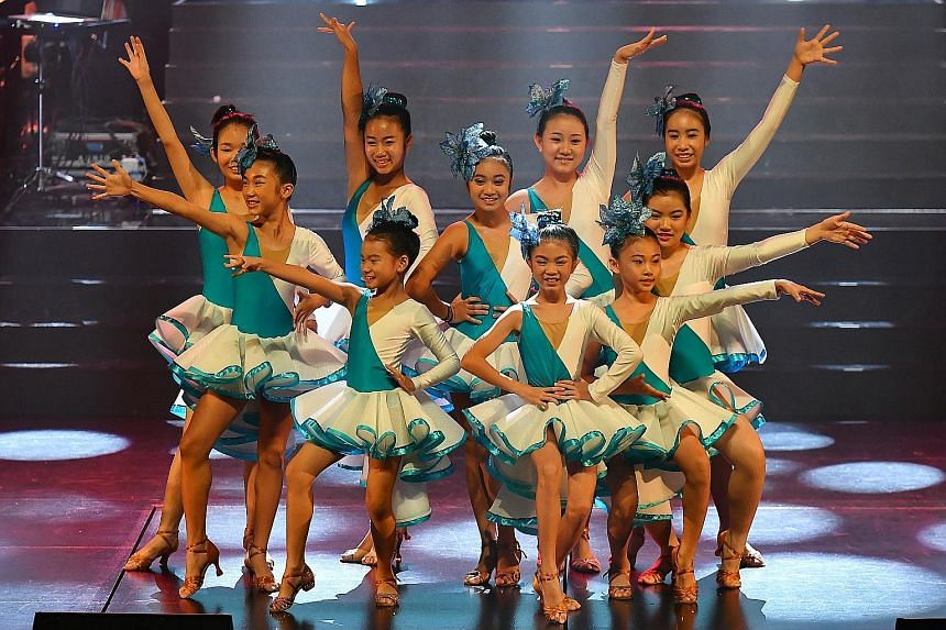 Young performers (first row, from left) Laura Maurer-Stroh and Aadeetiya Jayashanker, both aged 11; Estovan Cheah, seven; Cerilynn Law, 14; and Syah Rizuan Huslan, 12; (second row, from left) Mr Warren Fernandez, The Straits Times' editor and editor-