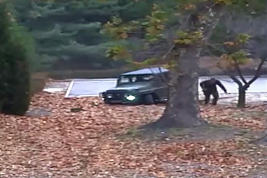Above: North Korean soldiers digging a trench on Wednesday in the area where a North Korean defector (left) dashed across the border with South Korea on Nov 13.