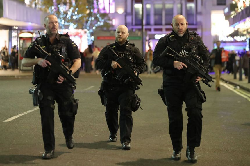 Armed police patrol near Oxford street as they respond to an incident in central London.