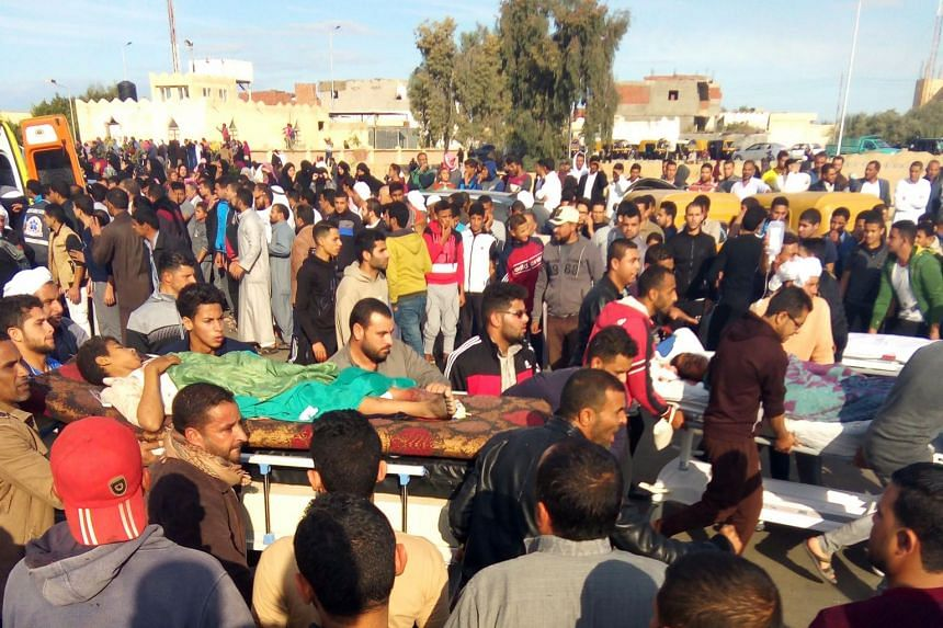 Egyptians carry victims on stretchers following a gun and bombing attack on the Rawda mosque near the North Sinai provincial capital of El-Arish.