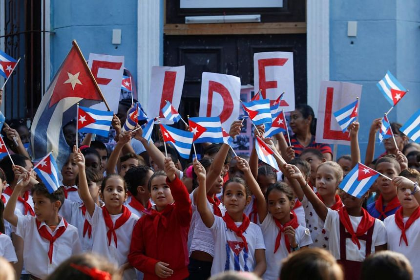 Children perform in a school to commemorate the first anniversary of the death of Cuba's late president Fidel Castro.