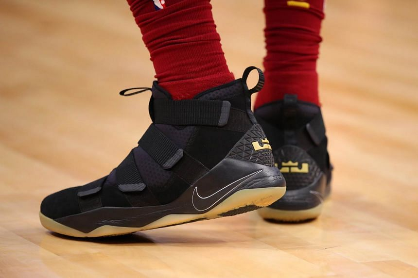 To rectify things, he switched out of a yellow pair of his Nike signature shoes and into a black pair.