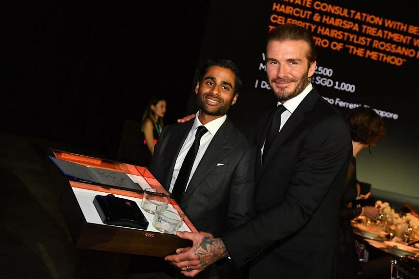 David Beckham with the winner of his Haig Club limited edition box set at the Singapore International Film Festival benefit dinner.