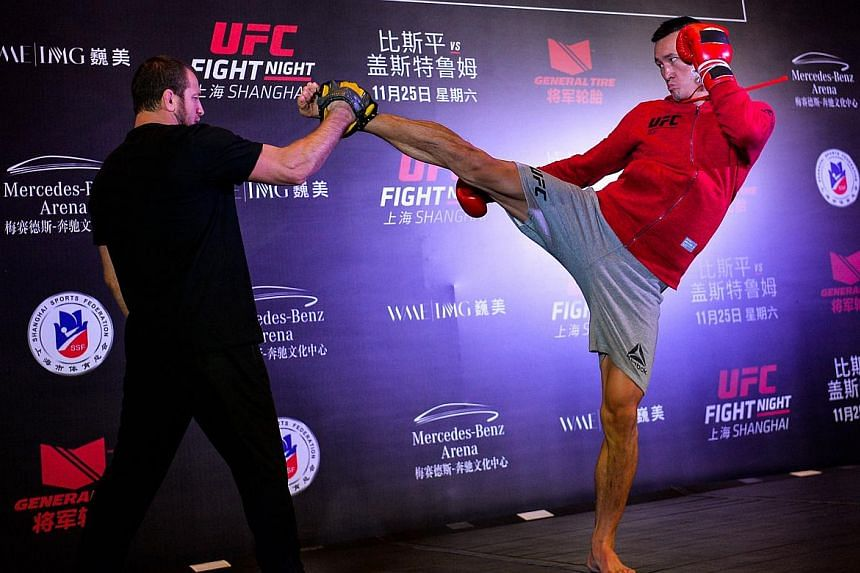 MMA fighter Wang Guan of China fights with a trainer during an open workout session prior to UFC Fight Night in Shanghai.
