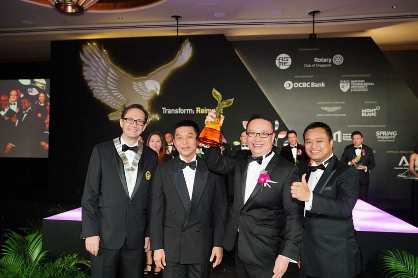 At the Entrepreneur of the Year Award ceremony on Thursday were (from left) Rotary Club of Singapore president Keith Harrison, Speaker of Parliament Tan Chuan-Jin, Ademco Security Group managing director Toby Koh, the overall winner in the Establishe