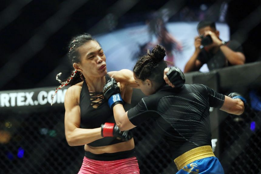 The One Championship women's strawweight bout between Tiffany Teo (left) and India's Puja Tomar last night lasted barely five minutes when Teo found her opening and locked Tomar in an armbar submission for the win.