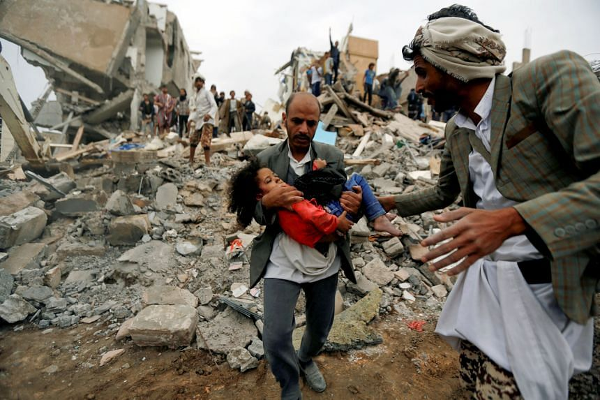 A man carrying an injured child rescued from the site of a Saudi-led air strike that killed eight of her family members in Sanaa, Yemen, in August. The writer says only Saudi Arabia can initiate a complete reboot of peace talks. It did so in 1965 to