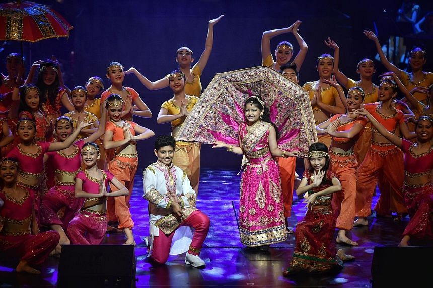 Taking centre stage are (from left) Aadeetiya Jayashanker, Jyotsnaa Jayashanker and Annette Yeong as they perform the song Mustapha during the India segment. They are joined by Jitterbugs Swingapore, ChildAid Dancers and ChildAid Symphonettes. Gisele