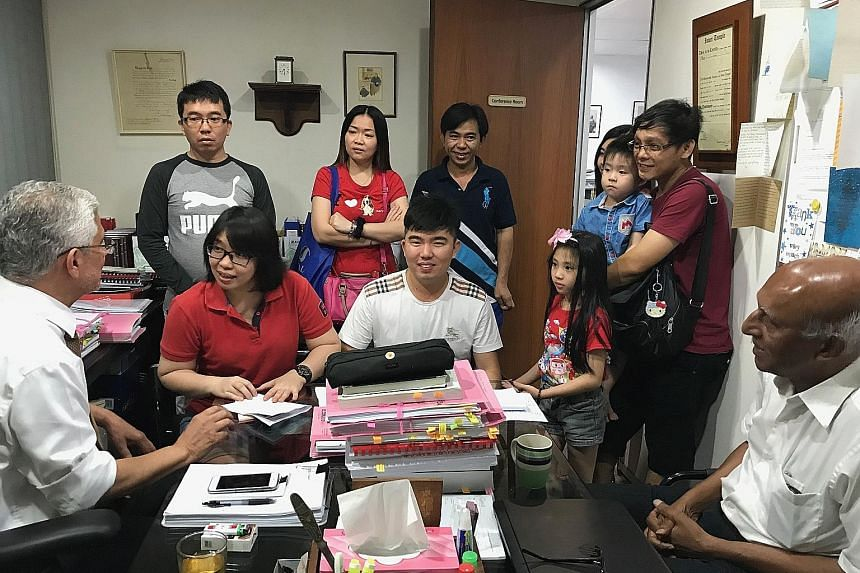 Ms Ting Swee Ling (in spectacles) with her lawyer Peter Fernando (far left) and her family members. The first thing that she did after being freed on Thursday was to head to Mr Fernando's office to thank him.