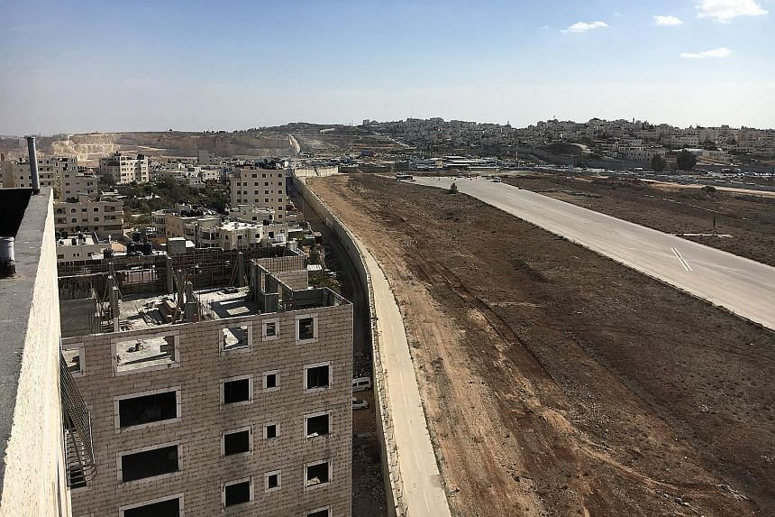 One of the buildings to be torn down in Kafr Aqeb. Residents have suggested shifting the wall to its right and using the road next to it instead.
