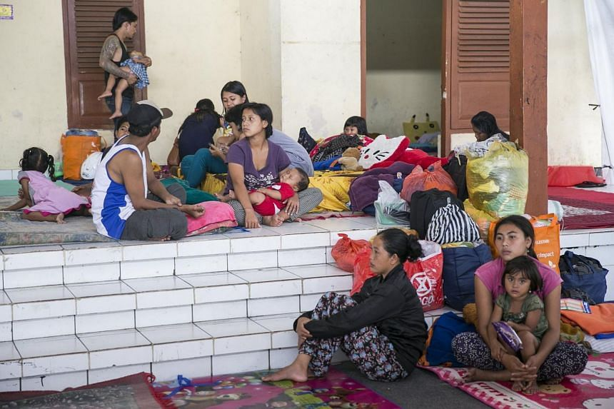 Evacuees stay at an emergency shelter as the Mount Agung volcano spews volcanic ash in Bali, Indonesia, Nov 26, 2017.