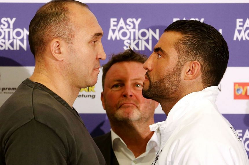Manuel Charr (right) facing Russian Alexander Ustinov during a press conference in Oberhausen on Nov 20, 2017. He overcame being shot and having a double hip replacement to become the WBA heavyweight champion on Nov 25.