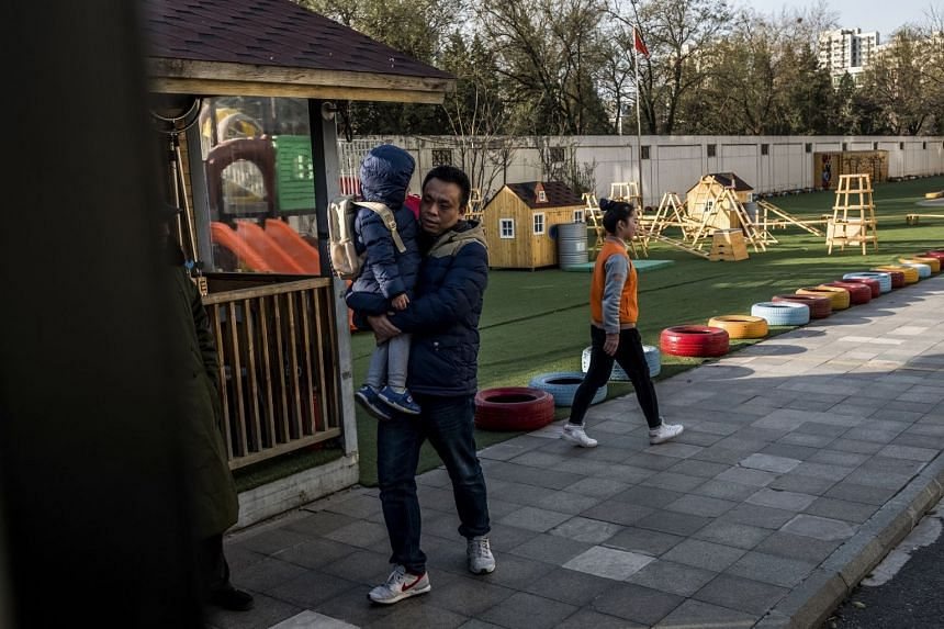 A father picks up his child from RYB Kindergarten in Xintiandi, in eastern Beijing.