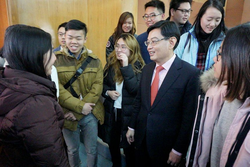 Finance Minister Heng Swee Keat speaking with Singapore students at Tsinghua University on Nov 25, 2017. Mr Heng said that there are opportunities for Singaporeans to learn from and collaborate with their Chinese counterparts.