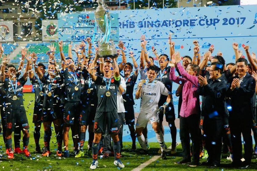 Albirex players celebrating with the RHB Singapore Cup trophy on Saturday to seal their quadruple feat.