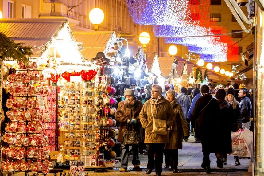 The boughs of the trees in Zrinjevac Park are decorated with fairy lights and the lanes (above) are filled with stalls selling handmade Christmas ornaments and trinkets and Christmas treats.