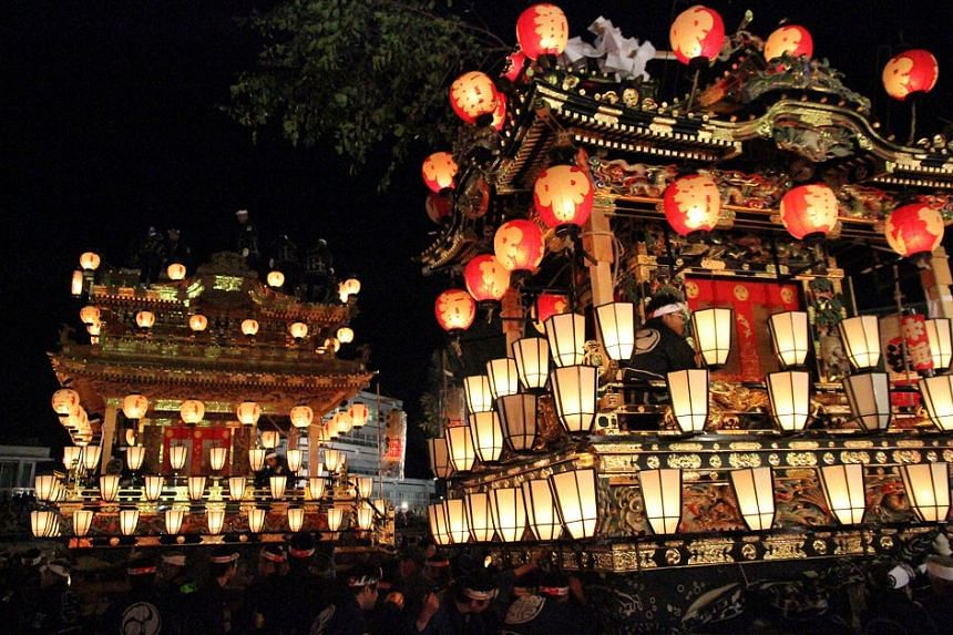 The festival is at its best on its second day, when large carved wooden floats (above) are paraded through the streets.