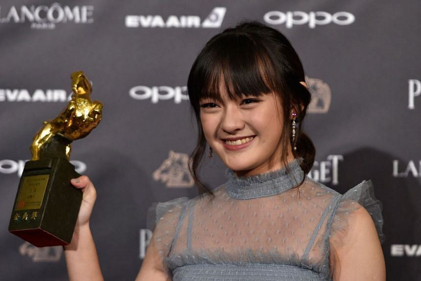 Taiwanese actress Vicky Chen poses after winning the Best Supporting Actress award for the film The Bold, The Corrupt, And The Beautiful.