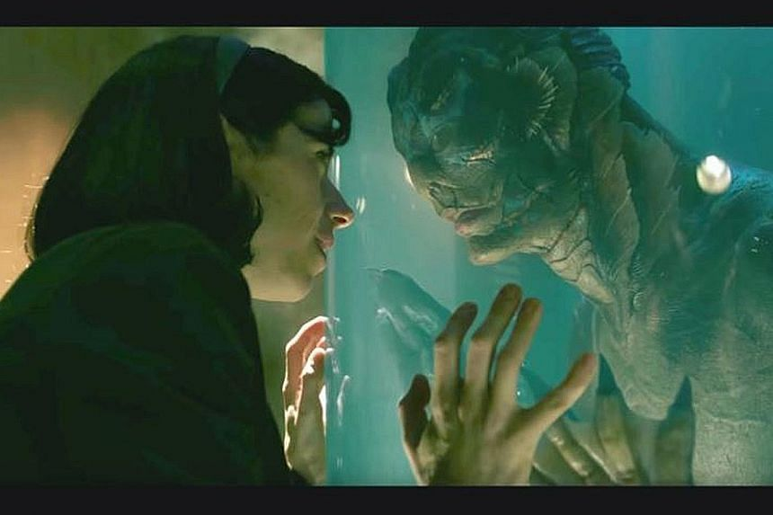 In The Shape Of Water, actor Doug Jones (left) plays a merman held captive in a research facility and becomes the love interest of a cleaning woman (played by Sally Hawkins, both far left).