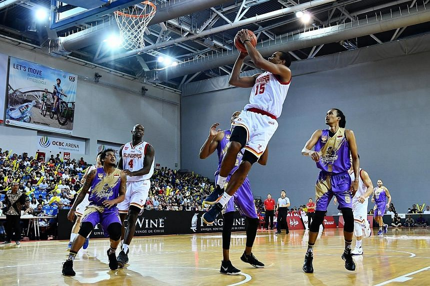 Singapore Slingers swingman Xavier Alexander jumps to shoot in the Asean Basketball League match against CLS Knights Indonesia at the OCBC Arena yesterday. Alexander posted a game-high 27 points, nine rebounds and seven assists to lead the Slingers t