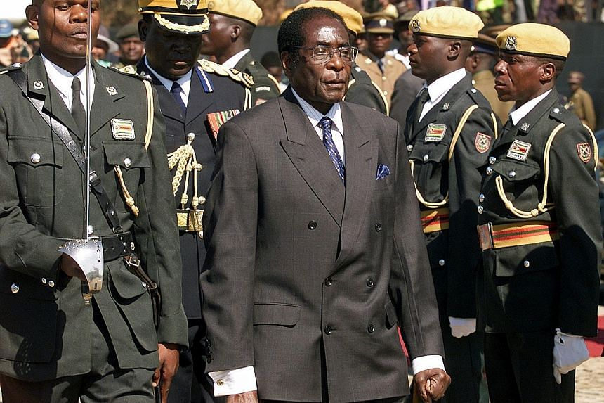 2003: An inspection of the presidential guard at the Heroes' Day ceremony in Harare.