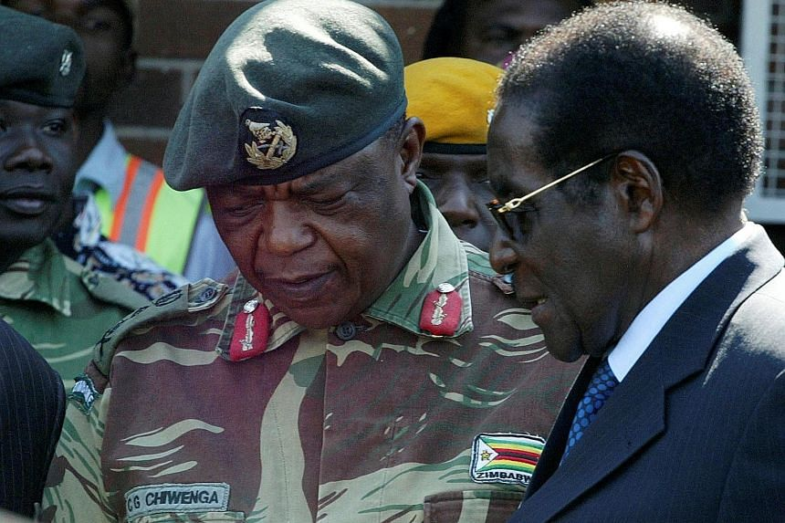 General Constantino Chiwenga with Mr Robert Mugabe in Harare, when the former president still held sway, in 2008.