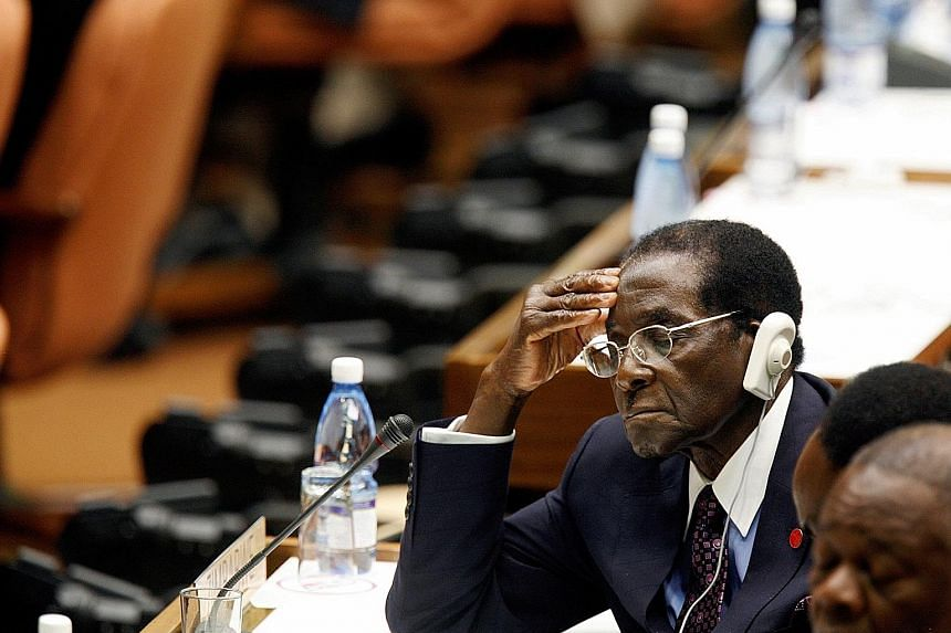 2006: Mr Mugabe listening to the closing statement from then acting Cuban president Raul Castro at the summit for non-aligned nations in Havana, Cuba. 1980: As Zimbabwean prime minister then, Mr Robert Mugabe, who was also leader of the Zimbabwe Afri
