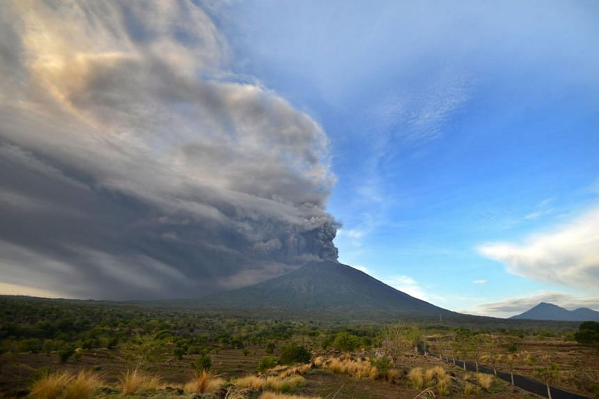 Mount Agung belched smoke as high as 1,500 metres above its summit, sparking an exodus from settlements near the mountain.