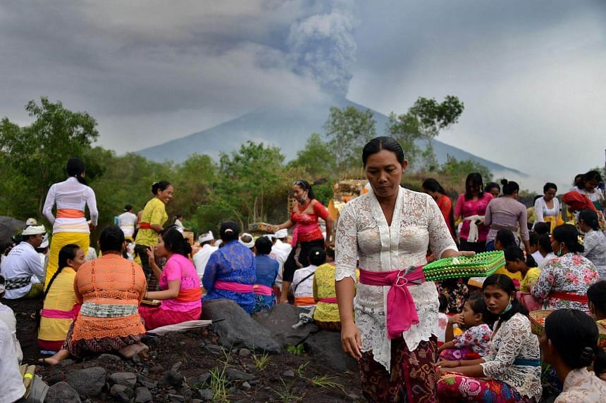 Balinese Hindus take part in a ceremony, where they pray near Mount Agung in hopes of preventing a volcanic eruption.