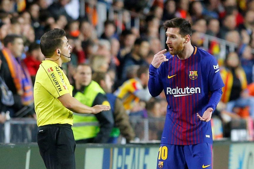 Barcelona's Lionel Messi remonstrates with the assistant referee during a match with LaLiga title rivals Valencia on Nov 26, 2017.