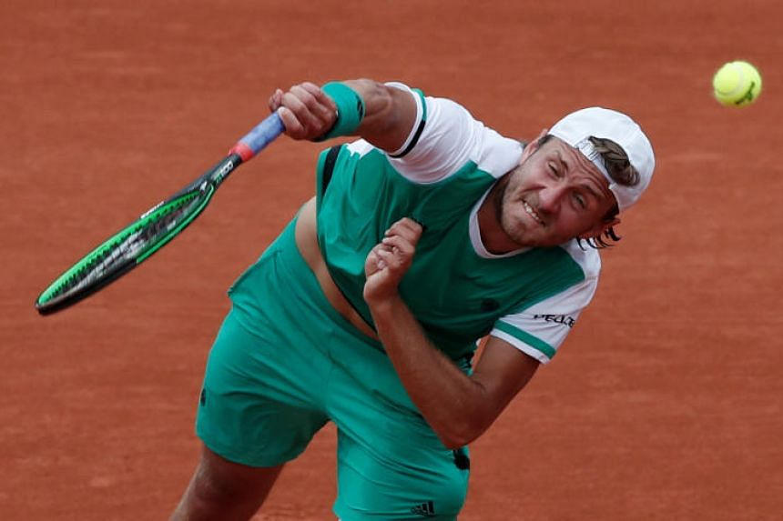 France's Lucas Pouille in action during his third round match against Spain's Albert Ramos-Vinolas at the French Open on June 2, 2017.
