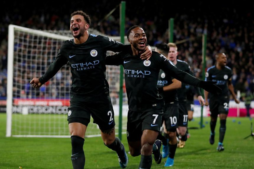 Manchester City celebrates scoring their second goal at the match with Huddersfield Town.