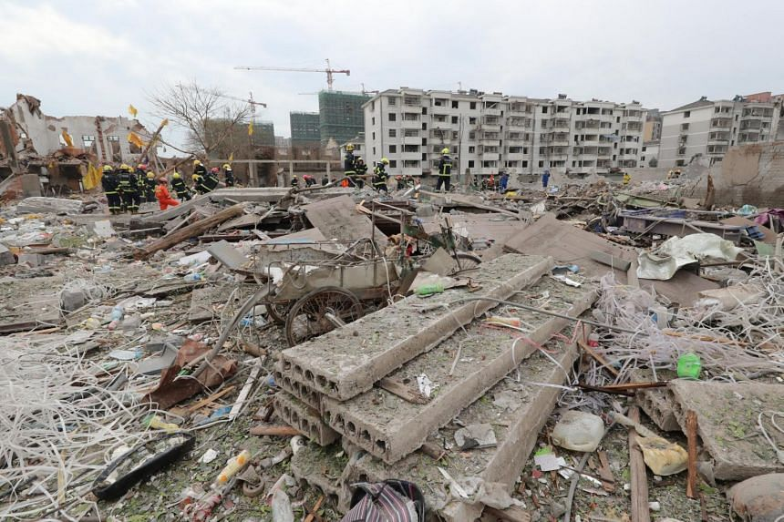 Chinese rescue workers search the site of the explosion in Ningbo city.