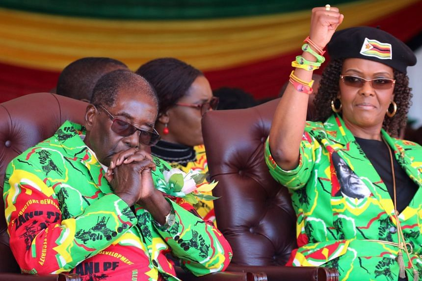 Zimbabwean President Robert Mugabe and his wife Grace attend a rally in Marondera, Zimbabwe, on June 2.
