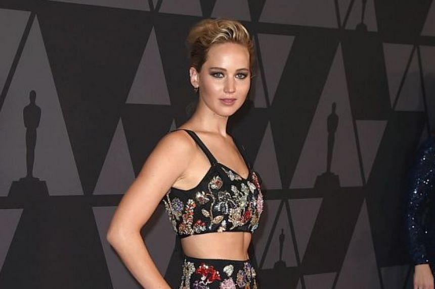 Actress Jennifer Lawrence (above) and director Darren Aronofsky dated for about a year.
