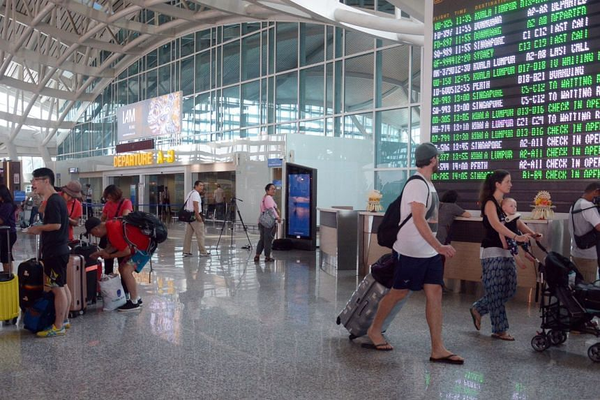 Some flights at Bali's Ngurah Rai airport resumed yesterday, but there were cancellations too.
