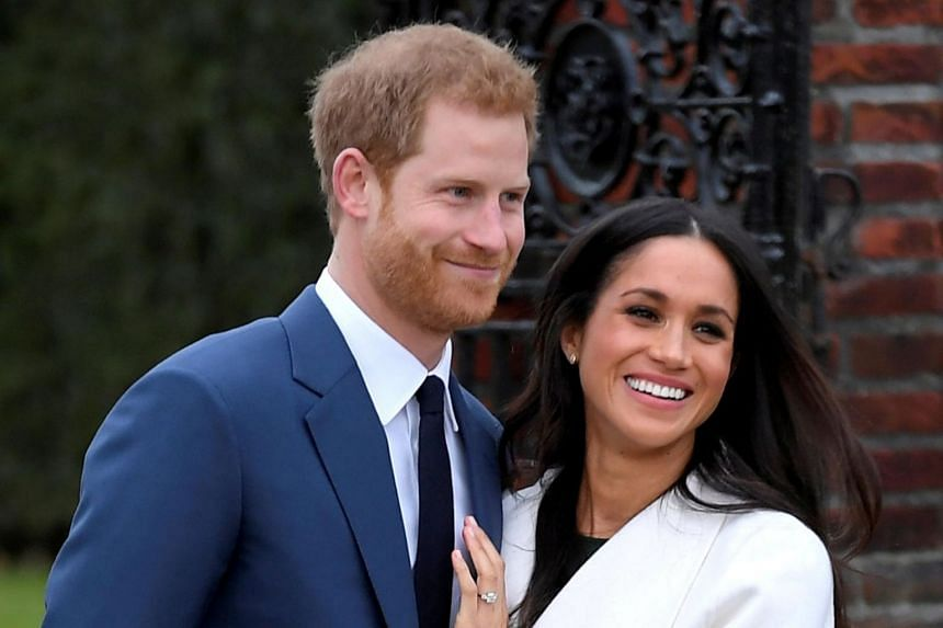 Prince Harry poses with Meghan Markle in the Sunken Garden of Kensington Palace, London.