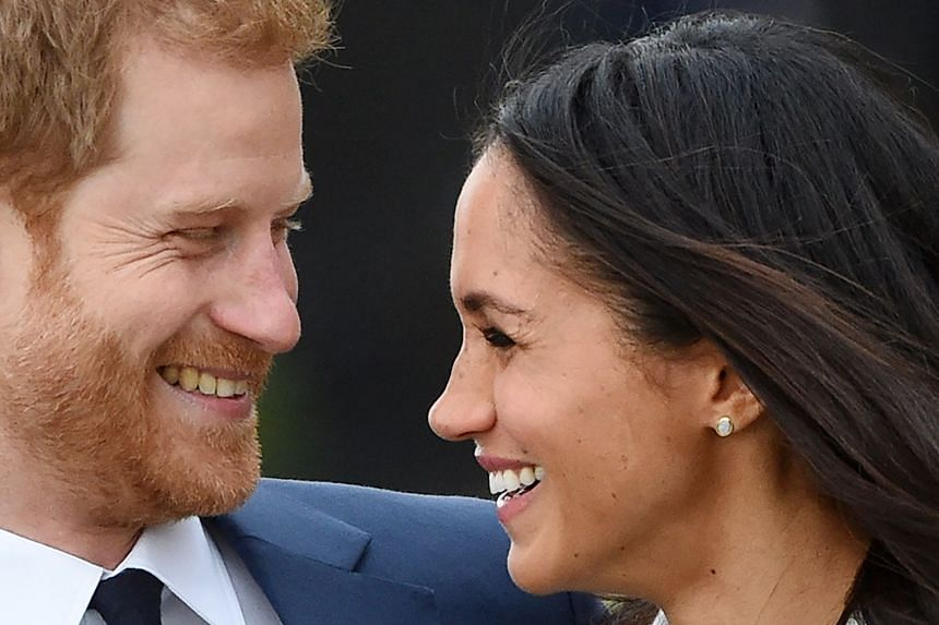 Prince Harry poses with fiancee Meghan Markle during a photocall after announcing their engagement.