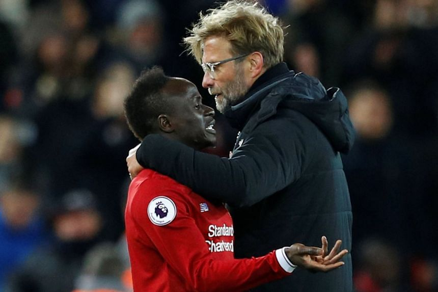 Liverpool manager Juergen Klopp hugging Sadio Mane, who saw action only in the 89th minute, after the 1-1 Premier League draw against Chelsea at Anfield on Nov 25, 2017. But he and Roberto Firmino are set to start against Stoke.