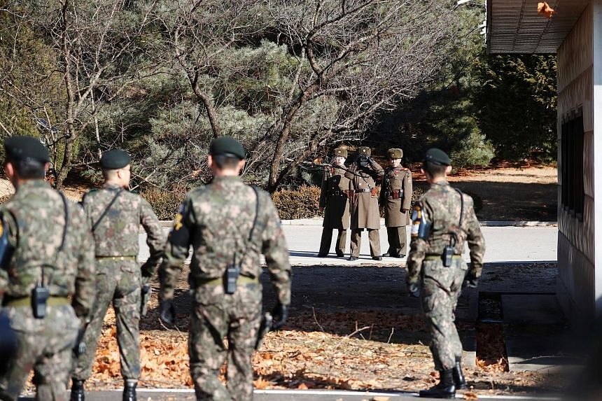 South and North Korean soldiers keeping watch on one another near the spot where a North Korean defected by crossing the border earlier this month.The South's Minister of Defence Song Young Moo commended the South Korean soldiers for rescuing the def
