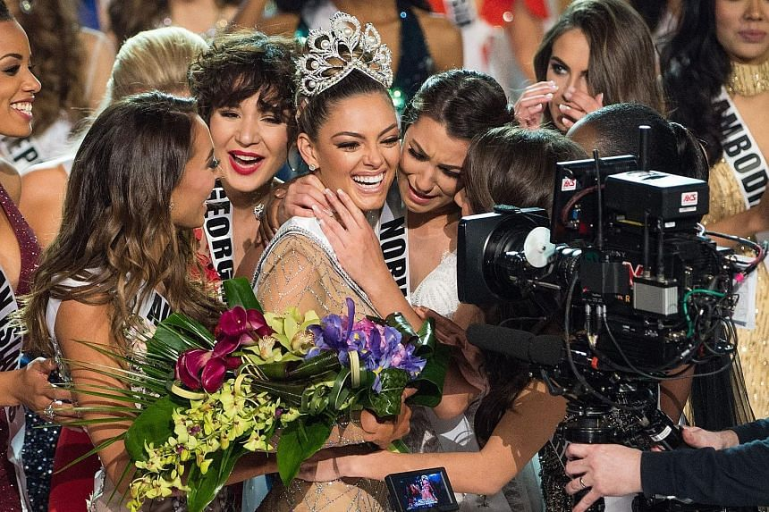 Miss South Africa Demi-Leigh Nel-Peters is congratulated by fellow contestants after being crowned Miss Universe at the end of the three-hour special programme on Fox. Contestants from around the world converged in Las Vegas on Sunday, where the 22-y
