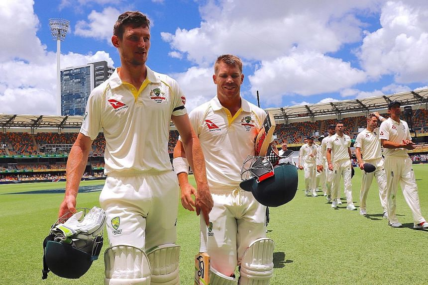 Australia's openers Cameron Bancroft (left, 82 not out) and David Warner (87 not out) after making short work of England in a 10-wicket first Ashes Test win in Brisbane yesterday.