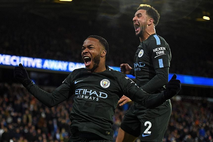 Manchester City winger Raheem Sterling (left) celebrating with Kyle Walker after his 84th-minute winner against Huddersfield on Sunday. The England international, one of City's stars this season, has scored 12 goals in 18 games in all competitions, h