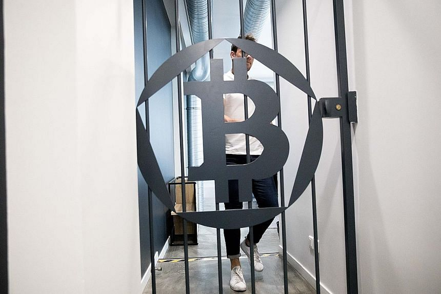 A bitcoin logo at the offices of La Maison du Bitcoin bank in Paris. Although the price of the largest cryptocurrency by market value is surging, not everyone agrees that bitcoin is an asset.