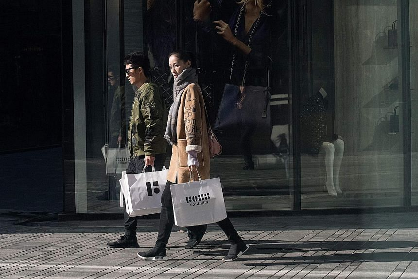 Shoppers in the popular Sanlitun district in Beijing. Consumption made up 64.7 per cent of China's gross domestic product growth last year, up from 44.9 per cent in 2010, and young people are the most active group of consumers in China today, says on