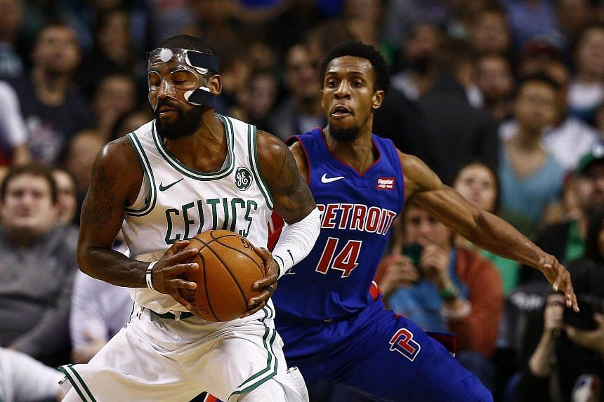 Detroit Pistons guard Ish Smith (right) defends against Boston Celtics guard Kyrie Irving (left).